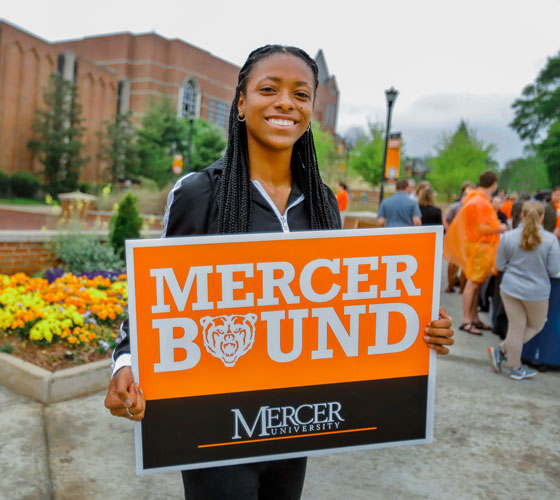 Student with Mercer Bound Sign